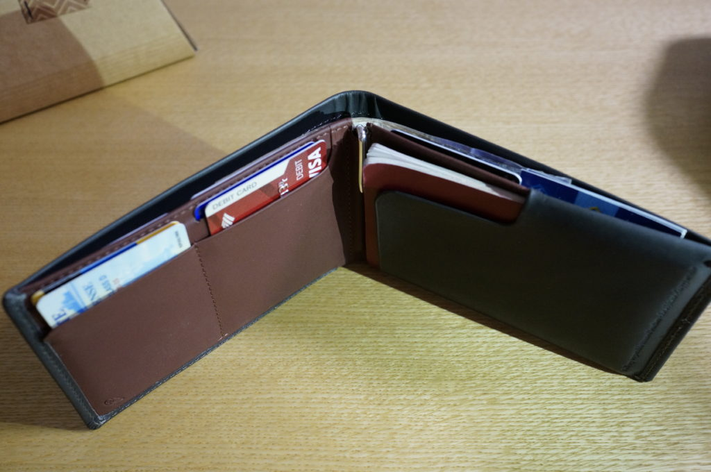 bellroy travel wallet open with things inside