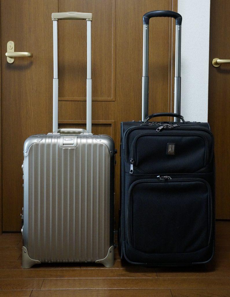 Rimowa titanium cabin trolley alongside travelpro flightcrew 5 handle extended