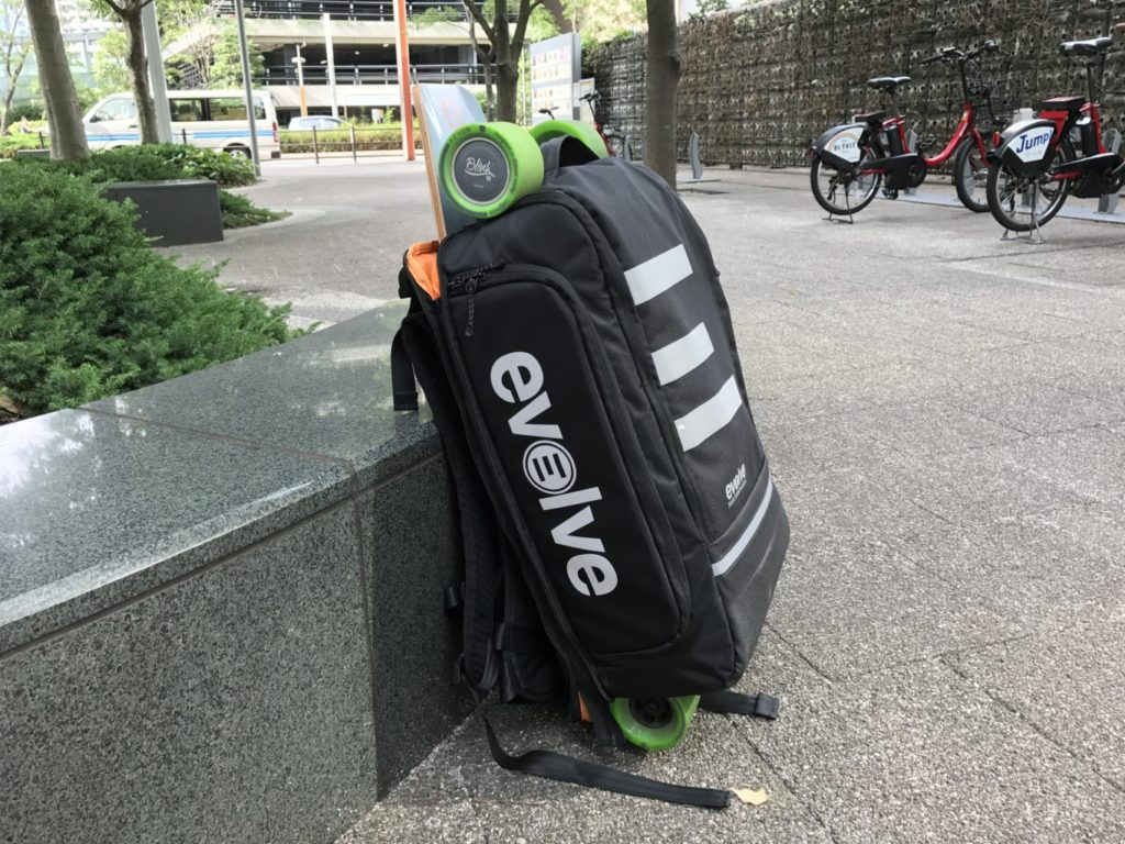 evolve backpack with skateboard attached